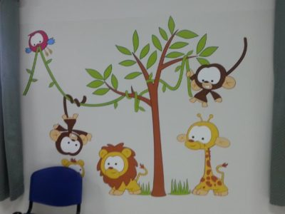 2016.07.07 Dodowa Hospital Photos - Wall stickers are put up in the paediatric ward, baby jungle scene